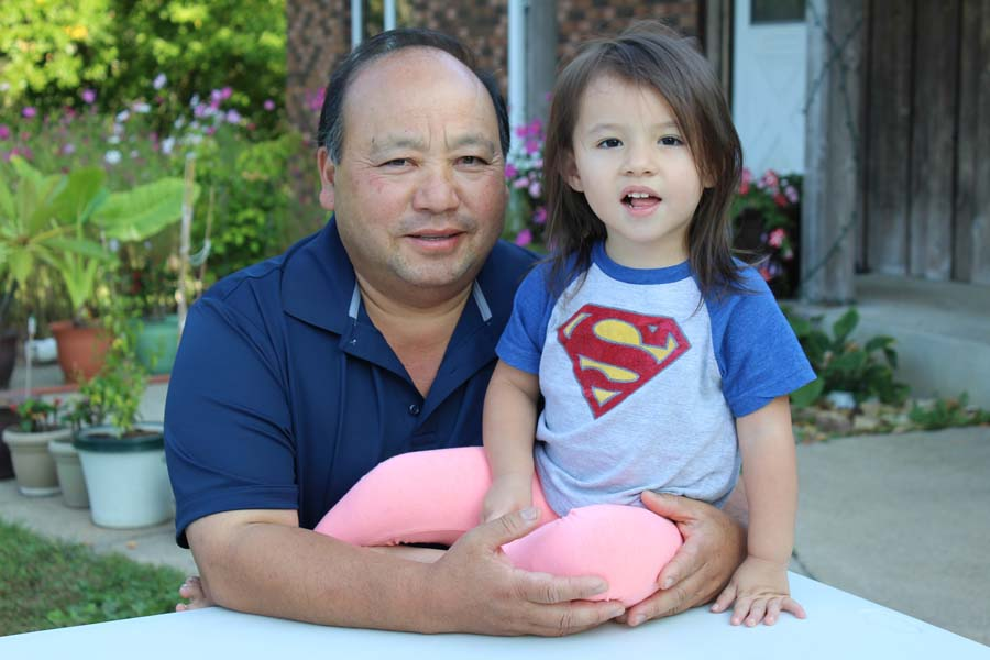 Bee Yang with his granddaughter